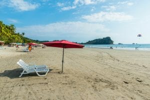 Parasol with chairs at Playa Espadilla at Manuel Antonio Park - Costa Rica