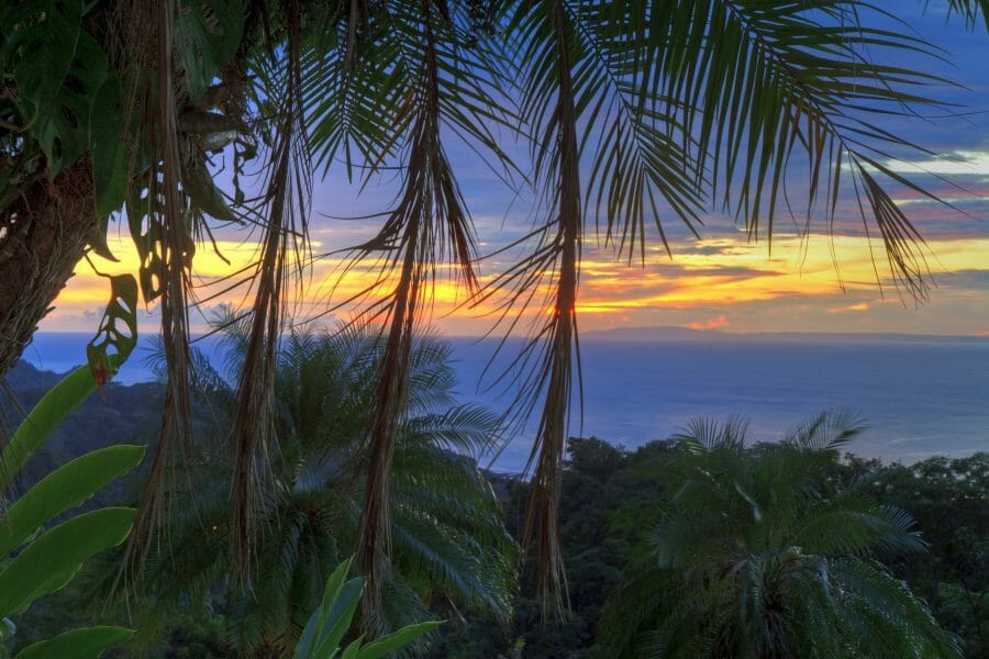 poolside beach overlooking the Pacific Ocean and Nicoya Peninsula at sunset near Tarcoles Costa Rica Colin Young 123rf
